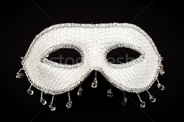 Stock photo: White mask isolated on black