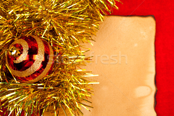 Christmas globe with golden  tinsel on old paper Stock photo © kalozzolak