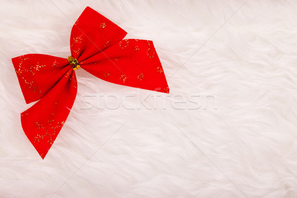 Small red Christmas ribbon on fluffy background Stock photo © kalozzolak