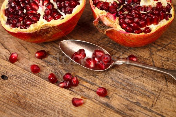 Magok teáskanál gránátalma gyümölcsök ezüst elöl Stock fotó © kalozzolak