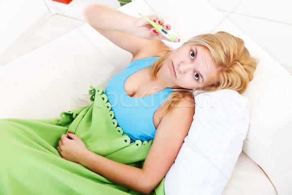Hasta kadın ateş sarışın kadın yatak Stok fotoğraf © kalozzolak