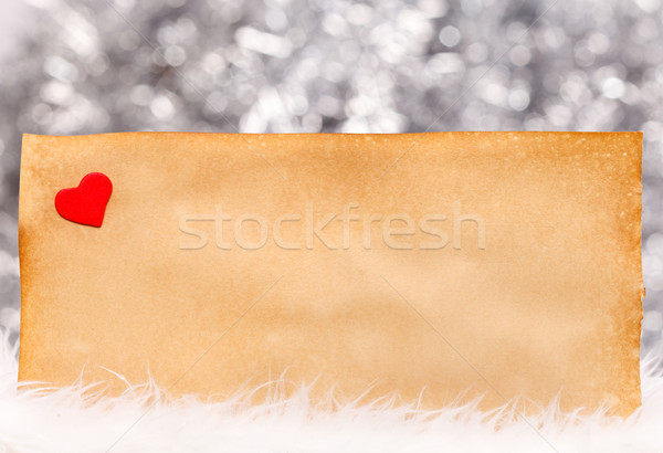 Small heart and old paper Stock photo © kalozzolak