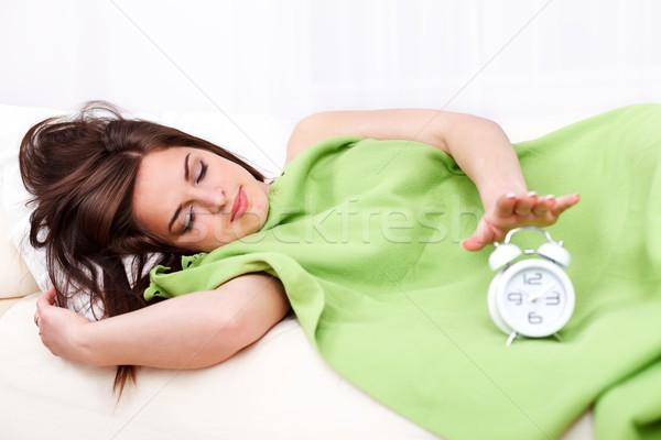 Assonnato donna letto sveglia fronte ragazza Foto d'archivio © kalozzolak