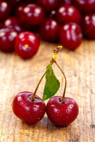 Cherries on rustic table Stock photo © kalozzolak