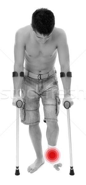 Hombre muletas joven aislado blanco médicos Foto stock © kalozzolak