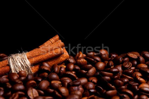 Cinnamon rolls on coffee beans Stock photo © kalozzolak