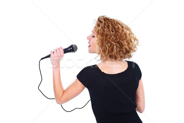 Stock photo: Girl holding microphone