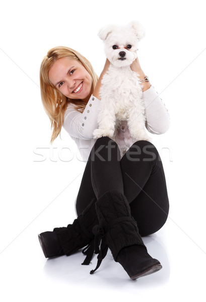 Joyful girl showing a cute small dog Stock photo © kalozzolak