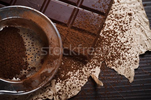 Cocoa dust on silver sieve Stock photo © kalozzolak