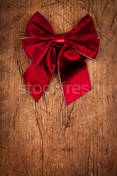 Claret bow on wooden table, Christmas decoration Stock photo © kalozzolak