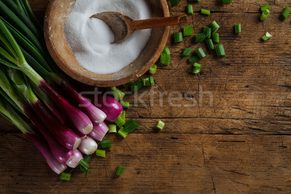 Fresh onion with old salt recipient Stock photo © kalozzolak