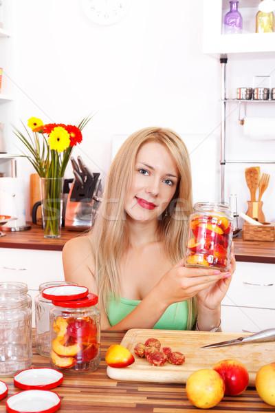 Making peach compote Stock photo © kalozzolak