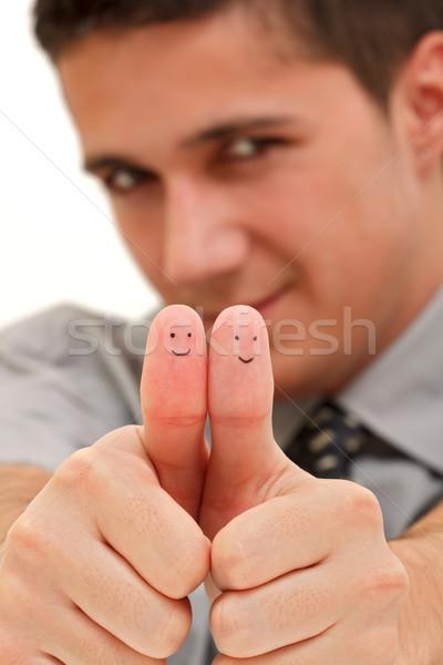 улыбаясь пальцы молодые бизнесмен улыбается Сток-фото © kalozzolak