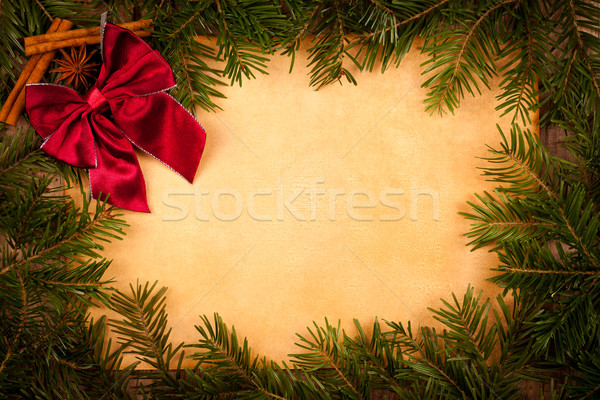 Claret bow on old paper, Christmas decoration Stock photo © kalozzolak