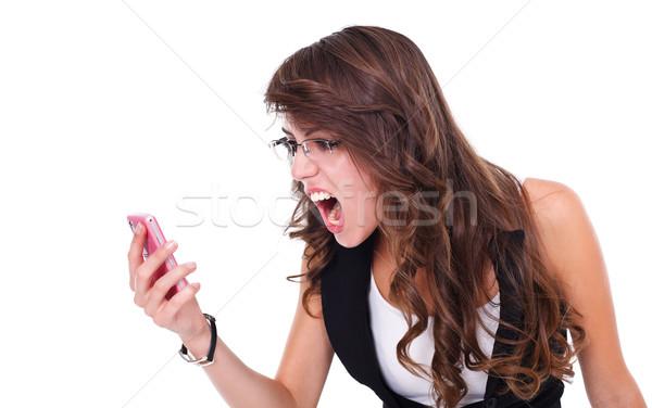 Meisje mobiele schreeuwen mobiele telefoon witte Stockfoto © kalozzolak