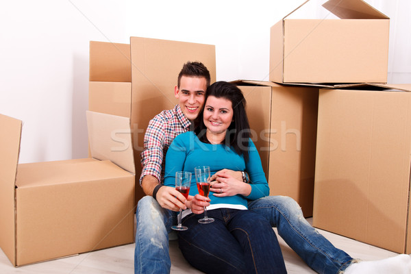 New home: happy moving coupe Stock photo © kalozzolak