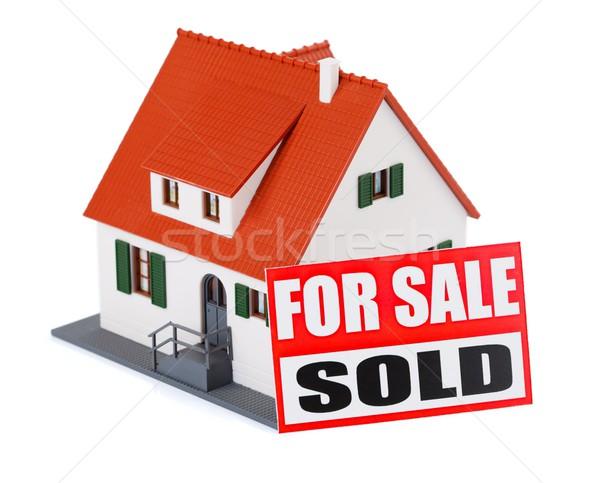 Home vendita miniatura casa segno venduto Foto d'archivio © kalozzolak