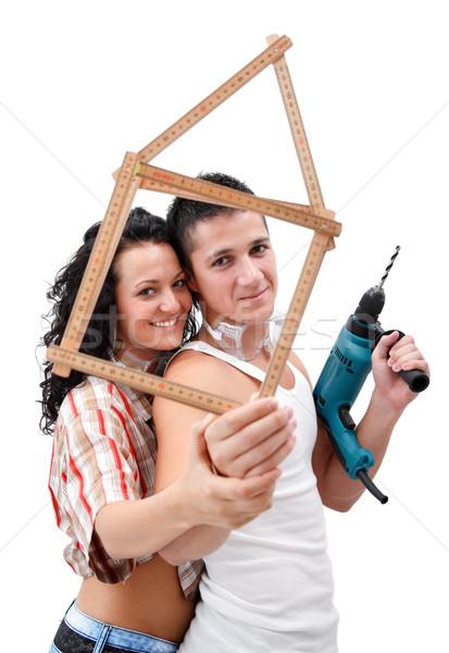 Couple with folding rule Stock photo © kalozzolak