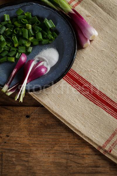 Tin plate on woven tablecloth Stock photo © kalozzolak