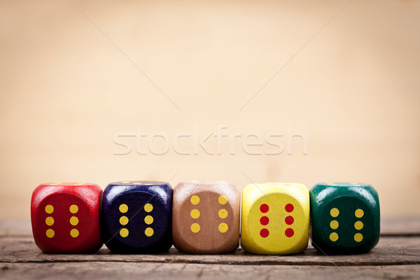Colorful wooden dices in line Stock photo © kalozzolak
