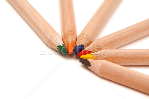Coloured pencils in semi-circle Stock photo © kalozzolak