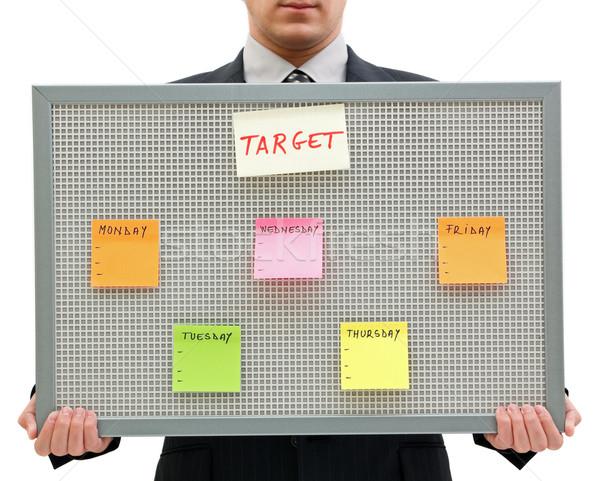 Heti cél üzletember tart emlékeztető tábla Stock fotó © kalozzolak