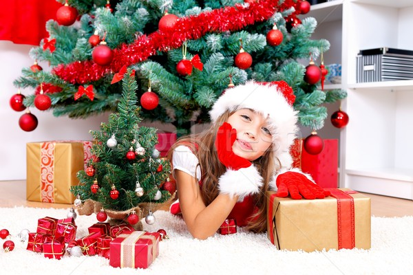 Karácsony lány imádnivaló ajándékok karácsonyfa boldog Stock fotó © kalozzolak