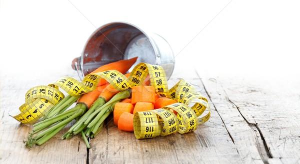 Fitness vida saudável cenouras fita métrica rústico tabela Foto stock © kalozzolak