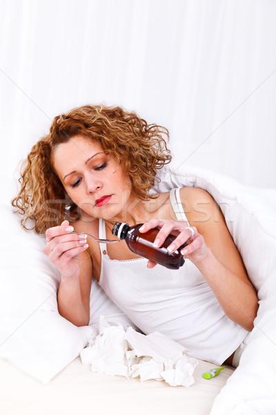 Nő elvesz szirup fiatal gyönyörű nő influenza Stock fotó © kalozzolak