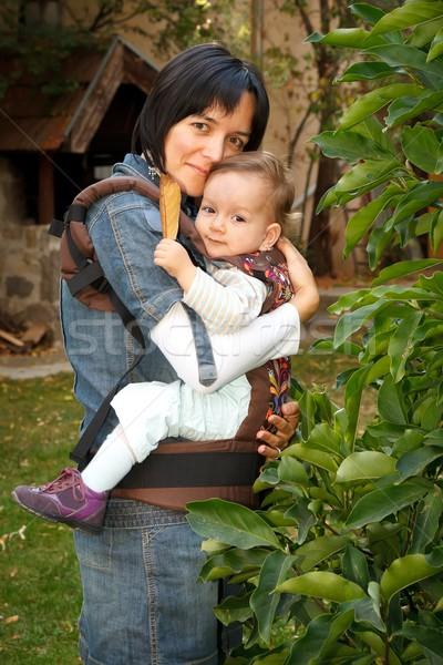 Anya baba csúzli hordoz kívül arc Stock fotó © kalozzolak