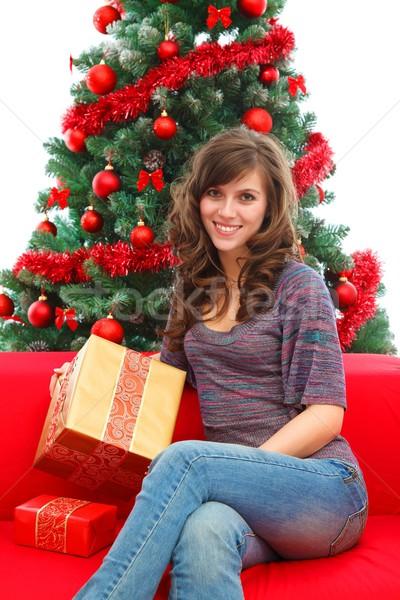 Christmas domu młoda kobieta prezenty posiedzenia choinka Zdjęcia stock © kalozzolak
