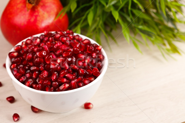 Stock photo: Grenadine seeds with fruit and leaves
