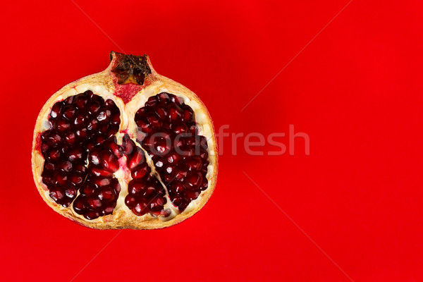 Half grenadine over red background Stock photo © kalozzolak
