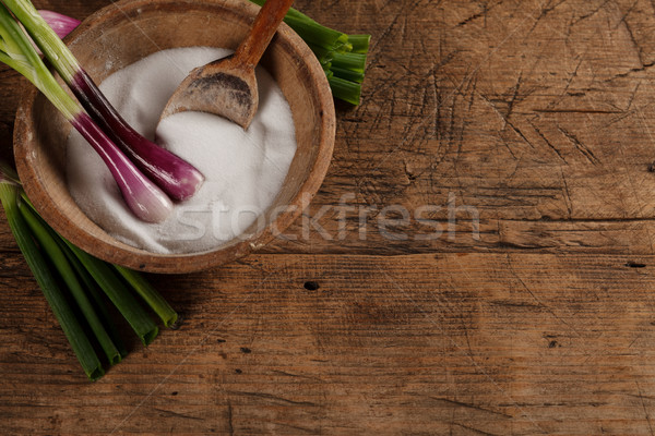 Old salt box with green onions Stock photo © kalozzolak