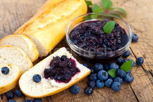 Baguette with blueberry jam Stock photo © kalozzolak