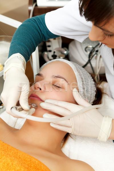 Travaux traitement de la peau client femme fille Photo stock © kalozzolak