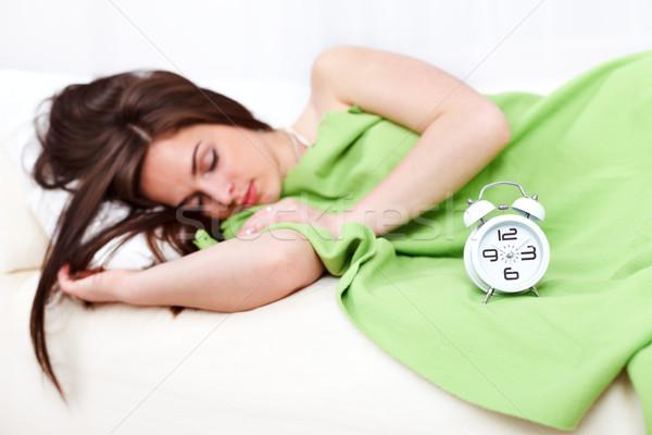 álmos nő ágy ébresztőóra elöl lány Stock fotó © kalozzolak