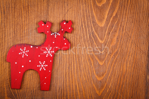 Red raindeer on wooden background Stock photo © kalozzolak