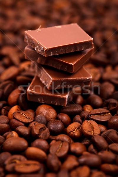 Chocolate bar on coffee beans Stock photo © kalozzolak