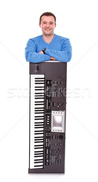 Posing with synthesizer Stock photo © kalozzolak