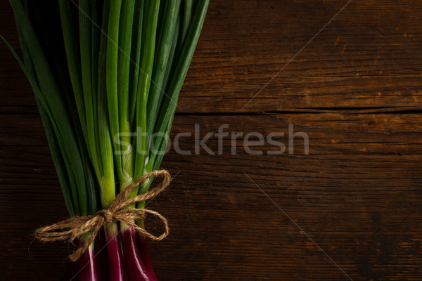 Onions tied with a rope Stock photo © kalozzolak