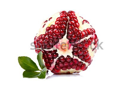 Pomegranate with green leaf Stock photo © kalozzolak