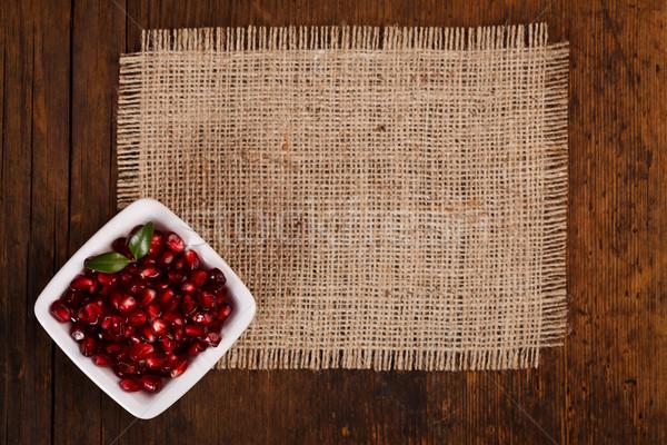 Stock photo: Grenadine seeds in white plate