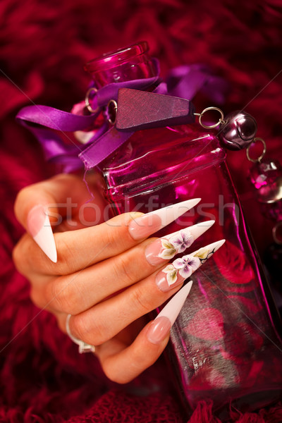 Nails and elixir bottle Stock photo © kalozzolak