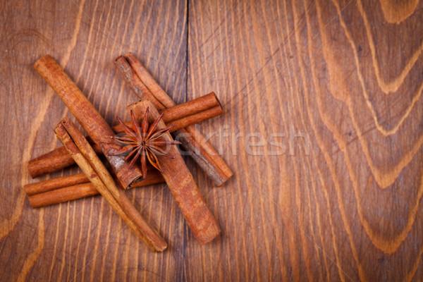 Cinnamon and star anise on wooden background Stock photo © kalozzolak