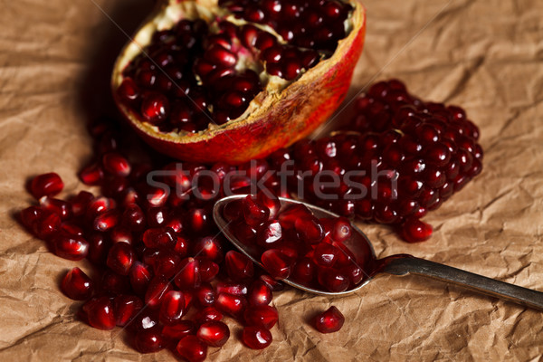 Gránátalma magok teáskanál gyümölcs ezüst rusztikus Stock fotó © kalozzolak