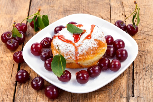 Donut confiture fruits cerises plaque rustique Photo stock © kalozzolak