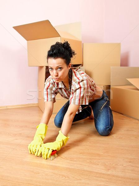 Fáradt háziasszony fiatal nő citromsárga gumikesztyű cserjék Stock fotó © kalozzolak
