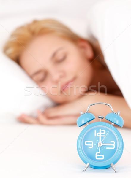 Kadın çalar saat genç kadın uyku yatak mavi Stok fotoğraf © kalozzolak
