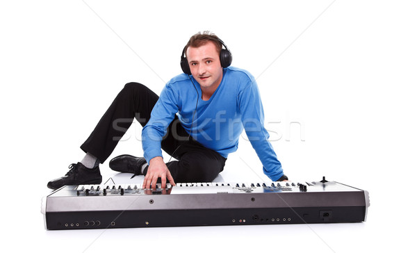 Man with synthesizer Stock photo © kalozzolak
